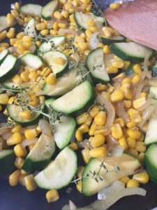 the ingredients for the zucchini corn frittata in the pan
